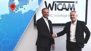 Geschäftsführer Timo Eigenblut (rechts) begrüßt Alexander Kühn (links) in der Unternehmenszentrale in Karlsruhe.